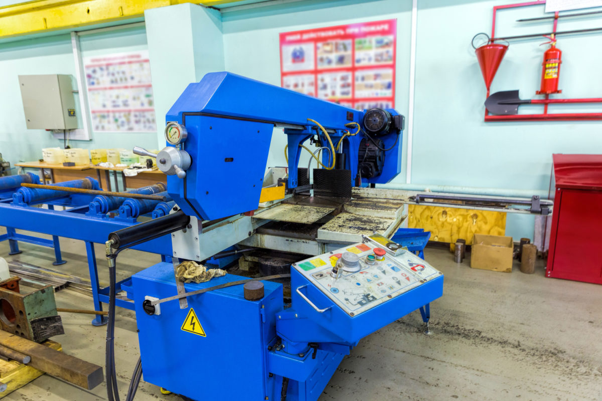 Semi-auto band saw in mechanical workshop